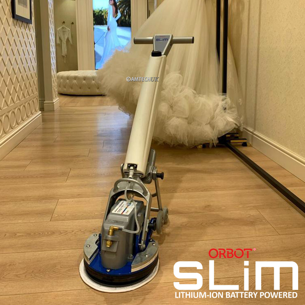 ORBOT SLiM cleaning a vinyl floor