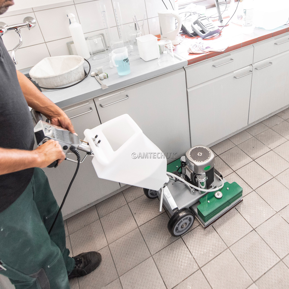 Oszilla machine cleaning tiled kitchen floor.