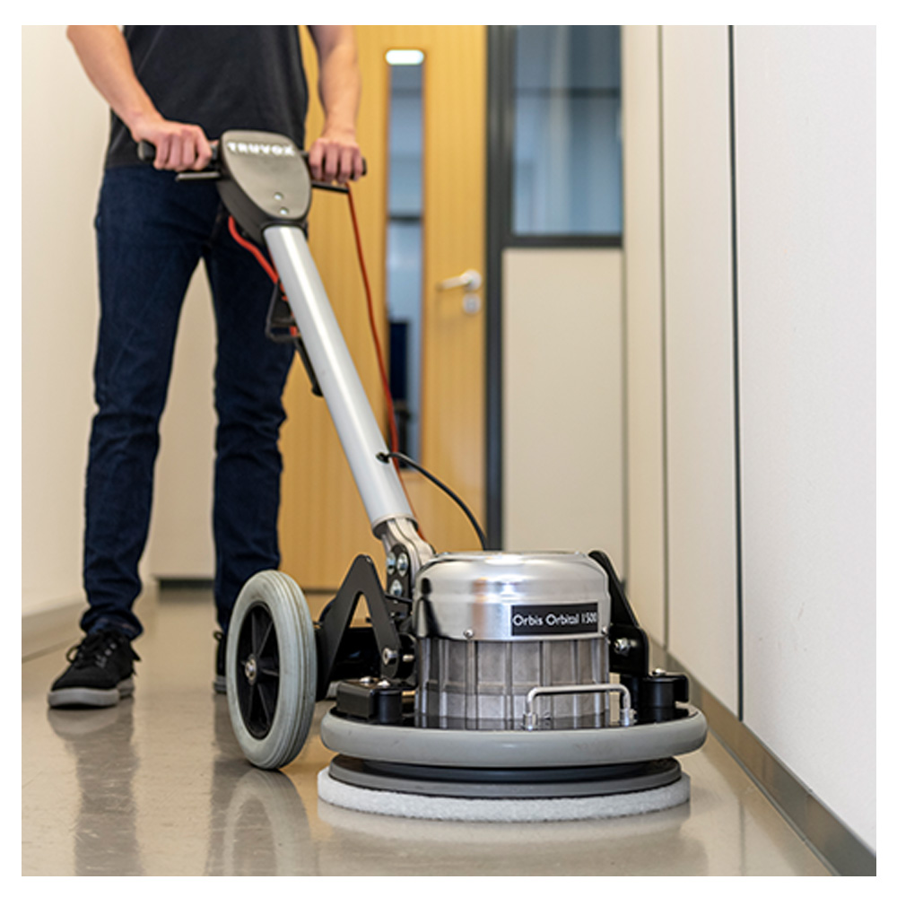 The Truvox Orbis Orbital 1500 floor machine in use by a cleaner.