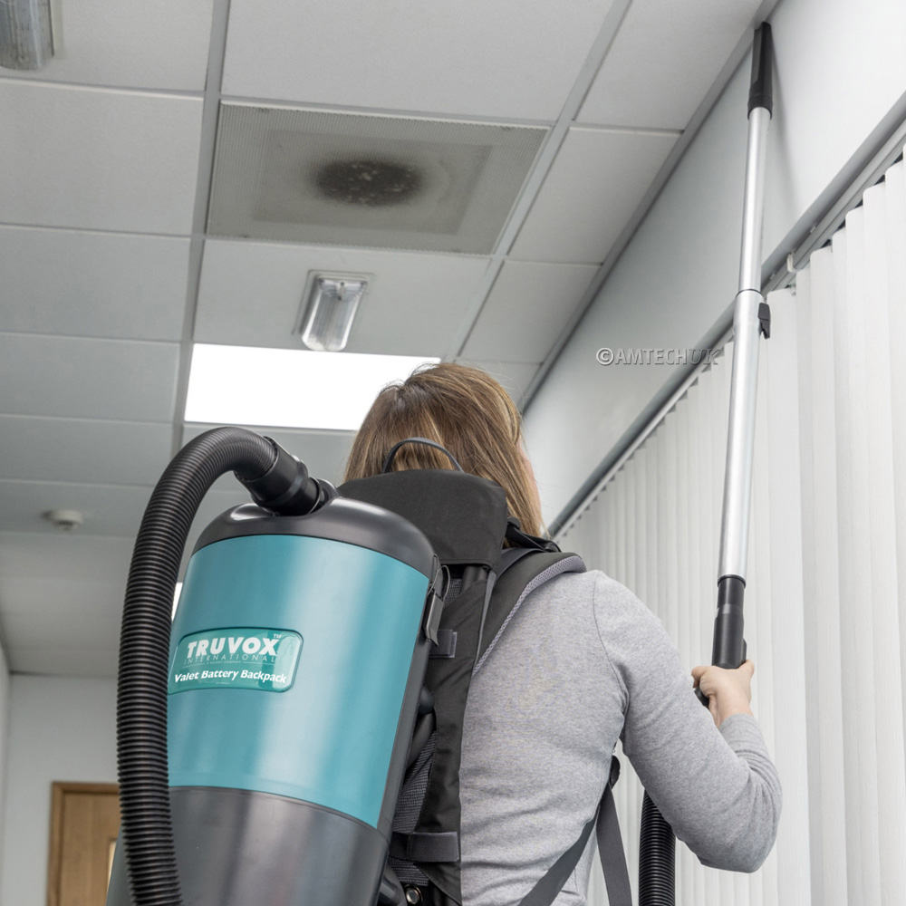 Truvox battery backpack vacuum cleaning ceilings.