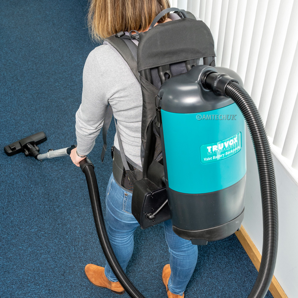 Truvox battery backpack vacuum cleaning carpets.