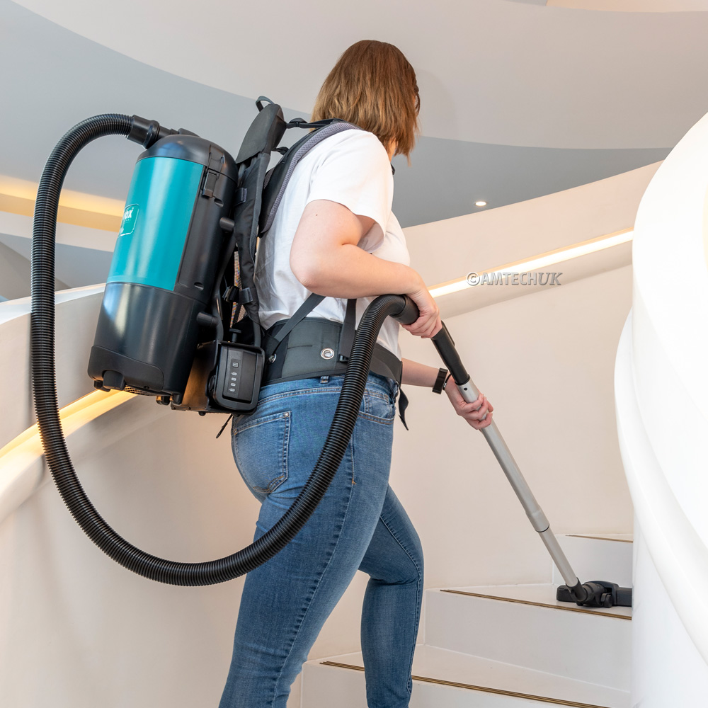 Truvox battery backpack vacuum cleaning stairs.