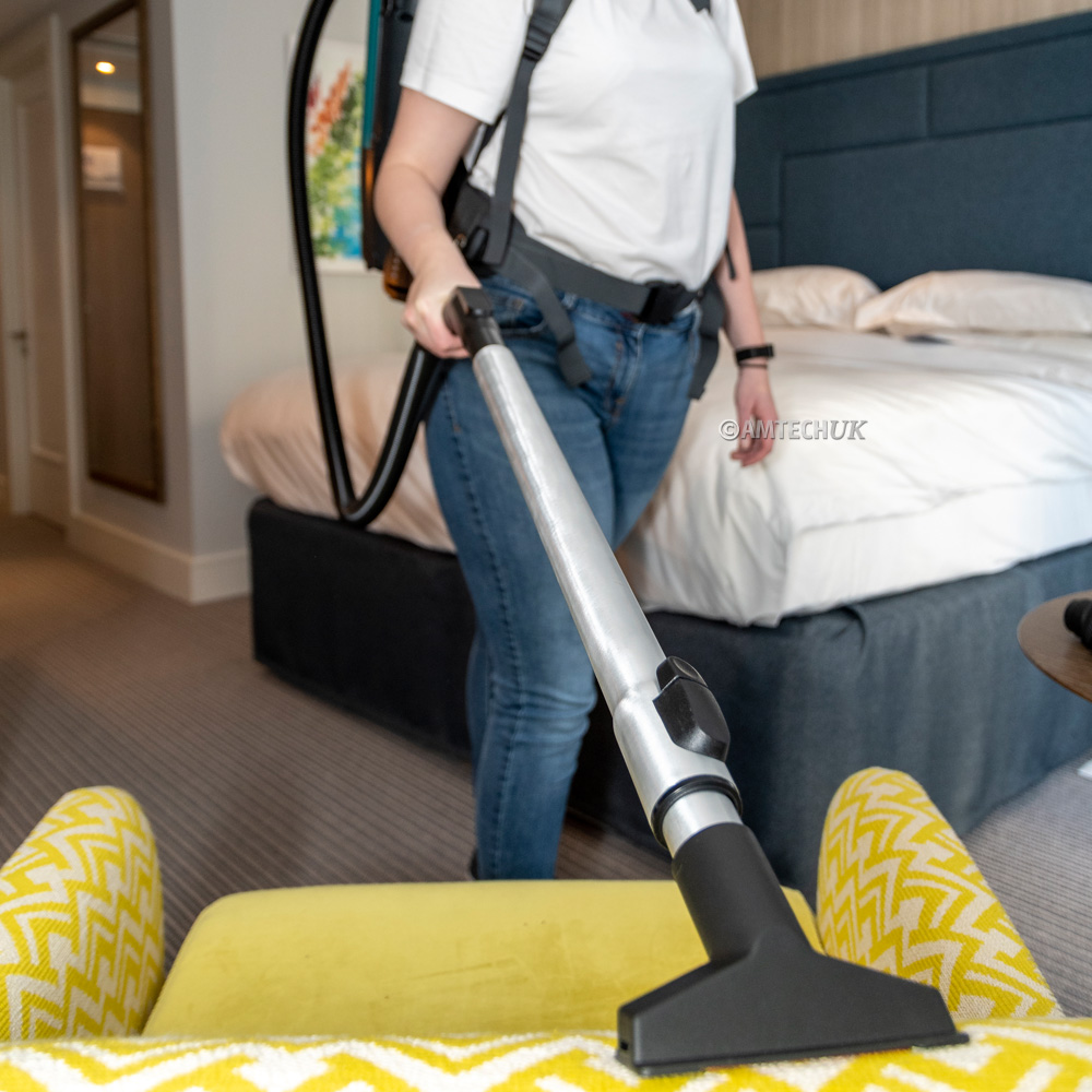 Truvox battery backpack vacuum cleaning hotel upholstery and sofa.