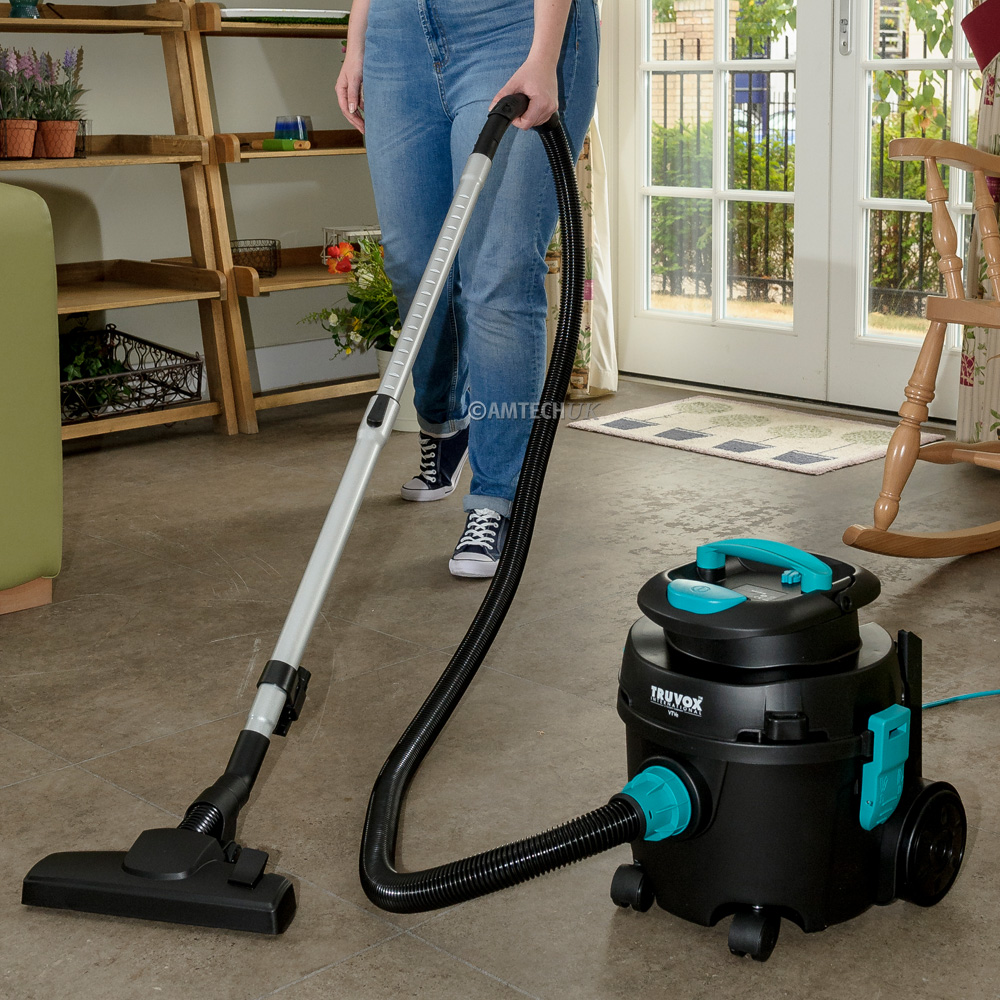 Truvox VTVe tub vacuum cleaner being used to clean hard floors.