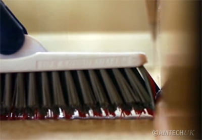 Shark tile and grout brush cleans close up to walls
