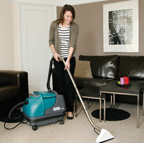 Woman cleaning carpet with Truvox Hydromist HD10